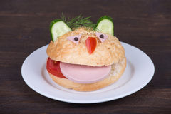 Fun food for kids - hamburger looks like a funny muzzle Royalty Free Stock Image