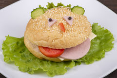 Fun food for kids - hamburger looks like a funny muzzle Royalty Free Stock Images