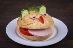 Fun food for kids - hamburger looks like a funny muzzle Stock Photography