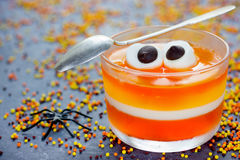 Fun food for kids - jelly with eyes on Halloween. Orange yellow Royalty Free Stock Image