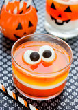 Fun food for kids - jelly with eyes on Halloween. Orange yellow Royalty Free Stock Photography
