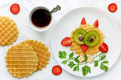 Fun food for kids owl sweet waffles with kiwi and strawberry. For kids breakfast stock photos