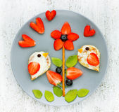 Fun with food - strawberry kiwi blueberry birds on flower. Fun with food - strawberry kiwi blueberry birds on a flower royalty free stock photos
