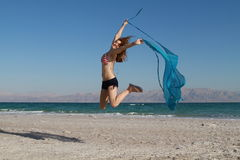 Fun freedom girl. Beautiful girl jumping on the beach with USA bathing suit Royalty Free Stock Photography