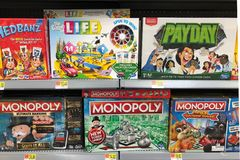 Fun Games in boxes for sale in a toy store. Various  games in boxes for sale in a toy store Stock Photo