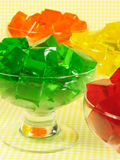 Fun Gelatin Desserts. Glasses of orange, green, red, and yellow cubed gelatin stock image