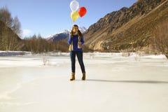 Fun girl with balloons on the hair Royalty Free Stock Photos
