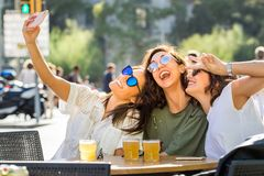 Fun girl friend selfie on terrace. stock image