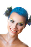 Fun girl with multicolor makeup and short blue hairstyle smiling Stock Image