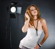 Fun girl in studio. Backstage in studio with monolight Royalty Free Stock Photos