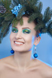Fun girl with xmas tree-wreath on head smiling on camera Stock Photography