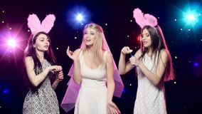 Fun girls at bachelorette party dancing and blowing soap bubbles. Girls at bachelorette party dancing, blowing soap bubbles, stroboscope lamps provide beautiful stock video