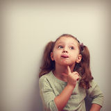 Fun grimacing girl thinking and looking up. Square vintage portr Royalty Free Stock Photo
