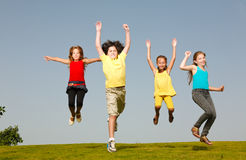 Fun group of kids jumping Royalty Free Stock Image