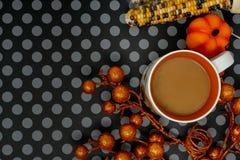 Fun Halloween background arrangement flat lay with coffee mug and indian corn. Fun Halloween background arrangement flat lay with coffee mug, pumpkins, glitter stock photography