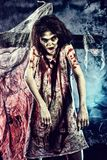 Fun halloween. Bloodthirsty zombi standing at the night cemetery in the mist and moonlight Stock Photos
