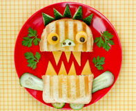 Fun Halloween monster sandwich with bread, cucumber and cheese o Stock Images