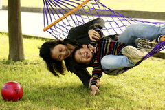 Fun with hammock 10. Mother and son playing happily in a hammock Royalty Free Stock Photos