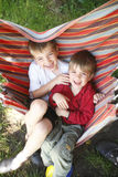 Fun in the hammock Stock Images
