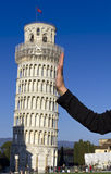 Fun. Hand leaning tower of Pisa Royalty Free Stock Photography