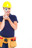 Looking cctv camera. Fun handywoman looking through cctv camera Royalty Free Stock Image