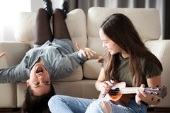 Fun and happiness in the house. Two sisters are enjoying time together stock photography