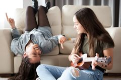 Fun and happiness in the house. Two sisters are enjoying time together royalty free stock photography