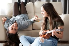 Fun and happiness in the house. Two sisters are enjoying time together stock photo