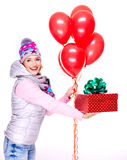 Fun happy adult woman gives the red gift box Royalty Free Stock Images