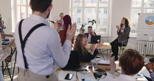Fun happy African business woman doing crazy celebration dance at modern loft office workplace, colleagues share success stock footage
