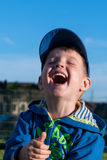 A fun, happy little boy laughs very much. Royalty Free Stock Photo