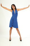 Fun happy pose by stunning young girl blue dress Royalty Free Stock Photography