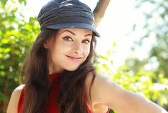 Fun happy woman in cap posing outdoors summer Stock Photo
