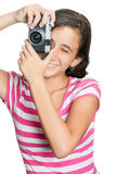 Fun happy young girl taking a photo Stock Image