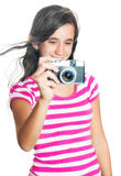 Fun happy young girl taking a photo Royalty Free Stock Image