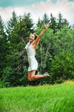 Fun happy young woman jumping up Royalty Free Stock Images