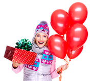 Fun happy young woman with red gift box and balloons Stock Photography
