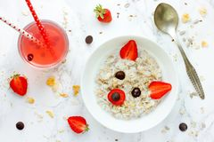 Fun and healthy breakfast idea for kids sweet oatmeal porridge b Royalty Free Stock Photography