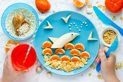 Fun and healthy food for kids fruit dolphin. Fun and healthy food for kids - fruit dolphin, summer season and sea vacation edible concept stock photo