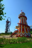 Fun Helter Skelter and ArcelorMittal Orbit. The regenerated urban area in Stratford that is now the Olympic Park. The helter skelter is a fun fairground ride Stock Photo