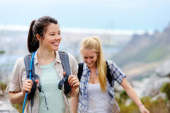 Fun hike outdoors. Friends hiking together outdoors exploring the wilderness and having fun royalty free stock image