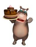 Fun Hippo cartoon character with cake Royalty Free Stock Photos