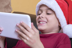 Fun with his tablet Royalty Free Stock Photography