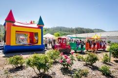 Fun house with train rain. Barn theme 2nd birthday with fun house and train ride royalty free stock photos