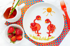 Fun idea for berry dessert for kids strawberry flamingo. Fun idea for berry dessert for kids - strawberry flamingo stock photos
