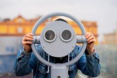 fun ideas. man looks through his binoculars on the lookout closeup Royalty Free Stock Photo