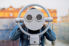 fun ideas. man looks through his binoculars on the lookout closeup Royalty Free Stock Image