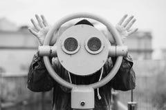fun ideas. man looks through his binoculars on the lookout closeup Stock Photos