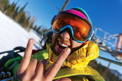 Fun image of young snowboarder Royalty Free Stock Images