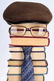 Fun. Joky image of the intellectual: books, eyeglasses, a necktie Royalty Free Stock Photo